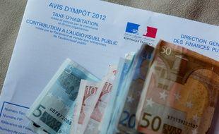 Illustration Taxe d'Habitation et billets en Euros. Lyon, le 29 décembre 2012. CYRIL VILLEMAIN/20 MINUTES