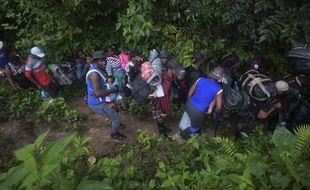 La jungle du Darien, à la frontière entre la Colombie et le Panama, est empruntée malgré le danger par de nombreux migrants avec enfants, désireux de rejoindre les Etats-Unis.