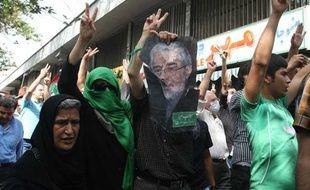 Des partisans de l'opposition manifestent à Téhéran le 18 septembre 2009.