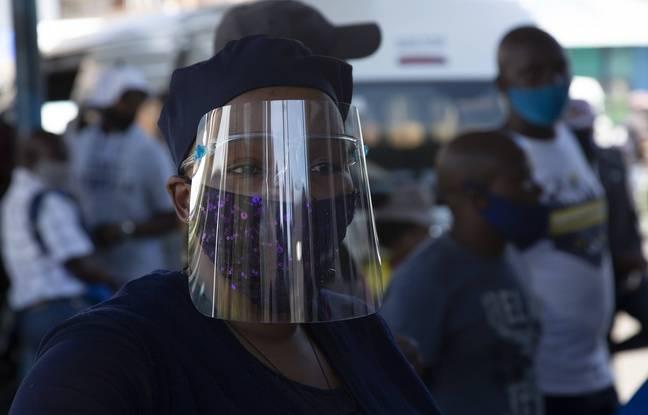 648x415 une femme avec un masque pour se proteger du coronavirus a johannesburg le 24 decembre 2020