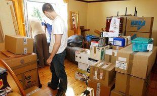 Les cartons s'entassent lors d'un déménagement chez un particulier.