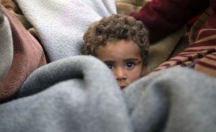 Un enfant syrien dans la région de la Ghouta, le 4/03/2018. AFP PHOTO / ABDULMONAM EASSA