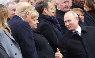 Donald Trump, Angela Merkel et Vladimir Poutine lors des commémorations du 11-Novembre à l'Arc de triomphe, le 11 novembre 2018.