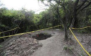Une fosse à Pueblo Viejo dans la banlieue d'Iguala (Mexique) où ont été retrouvés 28 corps, le 6 octobre 2014