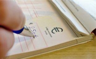 Le chèque est encore fréquemment utilisé en France.