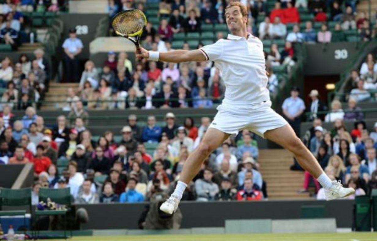 Richard Gasquet a été impressionnant d'autorité face à l'Espagnol Nicolas Almagro, sèchement écarté en trois sets 6-3, 6-4, 6-4, pour se qualifier vendredi pour les huitièmes de finale de Wimbledon – Andrew Yates afp.com