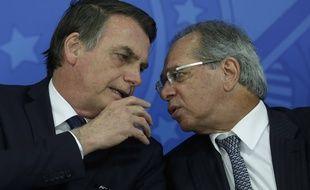 Le président du Brésil Jair Bolsonaro (à gauche) avec son ministre de l'économie Paulo Guedes, le 16 juillet 2019 à Brasilia.