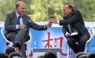 Pierre Moscovici et Pierre Gattaz, le 29 août 2013 à l'Université d'été du Medef