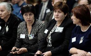Des proches des victimes de la prise d'otage de Beslan, à l'audience de la Cour européenne des droits de l'Homme le 14 octobre 2014 à Strasbourg