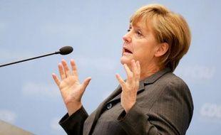 """La chancelière allemande Angela Merkel a expliqué lundi que l'Allemagne n'avait """"pas la force"""" de mettre sur pied de nouvelles mesures de relance sans risquer d'y """"perdre la confiance"""" dont elle jouit sur la scène internationale."""