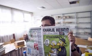 Le dessinateur Charb et un des dessins parus en septembre 2012