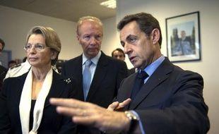 De gauche à droite, Michèle Alliot-Marie, Brice Hortefeux, et Nicolas Sarkozy, le 24 novembre 2009 à Epinay sur Marne