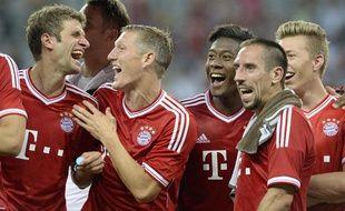 Les joueurs duBayern Munich, dont Franck Ribéry, lors d'un match amical contre Manchester City, le 1er août 2013, à Munich.