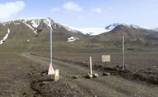 FILE - This is a Aug. 19, 2014 file image taken from video of  a sign is posted on the road next to Bardarbunga, a subglacial stratovolcano located under Iceland's largest glacier.  Earthquakes are rocking Iceland's Bardarbunga volcano, adding to concerns that magma movements may trigger an eruption that could hinder air traffic. Iceland's Met Office says two earthquakes measuring over magnitude 5 shook the volcano under the vast Vatnajokull glacier on Wednesday Aug. 27 2014. Some 500 quakes have hit the area since midnight.  (AP Photo/Courtesy Channel 2 Iceland, File) ICELAND OUT/LON805/390295547613/IMAGE FROM VIDEO. AP PROVIDES ACCESS TO THIS PUBLICLY DISTRIBUTED HANDOUT PHOTO PROVIDED BY CHANNEL 2 ICELAND FOR EDITORIAL PURPOSES ONLY. ICELAND OUT./1408271458