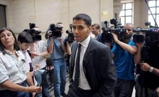 M'Hamed Bellouti (C) arrives at the Paris courthouse on June 25, 2008, for the trial in which he is sueing French President Nicolas Sarkozy's 21-year-old son Jean Sarkozy. Jean Sarkozy, a law student who this year made his political debut as local councillor in a wealthy Paris suburb, allegedly crashed his scooter into the rear of M'hamed Bellouti's BMW car in October 2005 before speeding off. AFP PHOTO MARTIN BUREAU