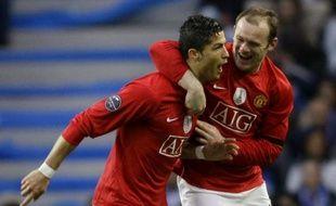 Les joueurs de Manchester United Cristiano Ronaldo et Wayne Rooney lors de la victoire face à Porto en Ligue des champions, le 15 avril 2009.