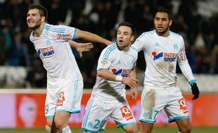 Mathieu Valbuena et Dimitri Payet avec André-Pierre Gignac lors du match contre Toulouse le 2 février 2014.