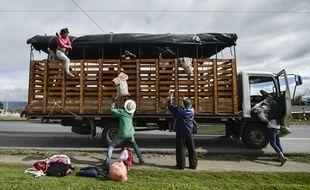 Des migrants vénézuéliens le 23 août 2018 en route pour le Pérou où elle tentera de trouver refuge.