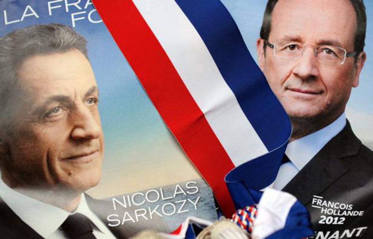 Montage photo des posters de campagne de Nicolas Sarkozy et François Hollande. – FRANCK FIFE / AFP