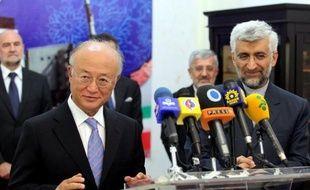 """L'Agence internationale de l'énergie atomique (AIEA) et l'Iran se sont mis d'accord sur une """"approche structurelle"""" visant à résoudre les questions en suspens sur le programme nucléaire controversé de Téhéran, a annoncé mardi le directeur général de l'agence Yukiya Amano."""