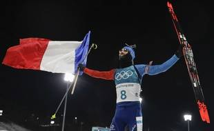 Martin Fourcade, of France, celebrates his gold medal finish in the men's 12.5-kilometer biathlon pursuit at the 2018 Winter Olympics in Pyeongchang, South Korea, Monday, Feb. 12, 2018.
