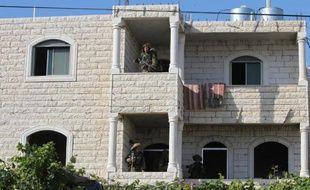 Des soldats israéliens ont investi une maison appartenant à des Palestiniens à Tapuah, en Cisjordanie, le 18 juin 2014 dans le cadre des opérations de recherche des 3 Israéliens disparus depuis 6 jours