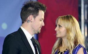 Repérée Nicole Richie lees yeux dans les yeux de Joel Madden, à la cérémonie d'illumination de Noël de l'Unicef.