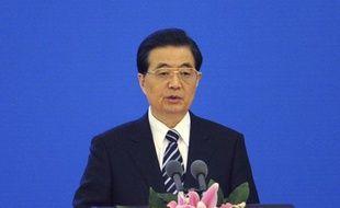 """Le président chinois Hu Jintao a lancé une mise en garde contre les forces """"hostiles"""" qui tentent selon lui """"d'occidentaliser"""" la culture de la Chine et a souhaité que celle-ci soit davantage promue à l'étranger."""