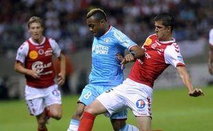 Marseille, qui sort d'une saison médiocre (10e place) et suit une cure d'austérité, a démarré dimanche sa saison du bon pied par une victoire, longue à se dessiner, sur le terrain de Reims (1-0), un promu privé d'élite depuis 33 ans, en clôture de la 1ère journée de L1.