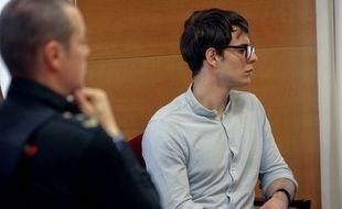 Patrick Nogueira, accusé d'avoir dépecé son oncle et sa tante et tué leurs enfants, lors de son procès le 24 octobre 2018.