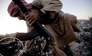 La photo d'un rebelle syrien envoyée à AP, retouchée par le photographe freelance qui l'a prise en septembre 2013.