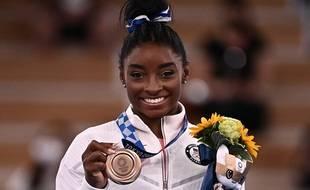 Simone Biles médaille de bronze à la poudre.
