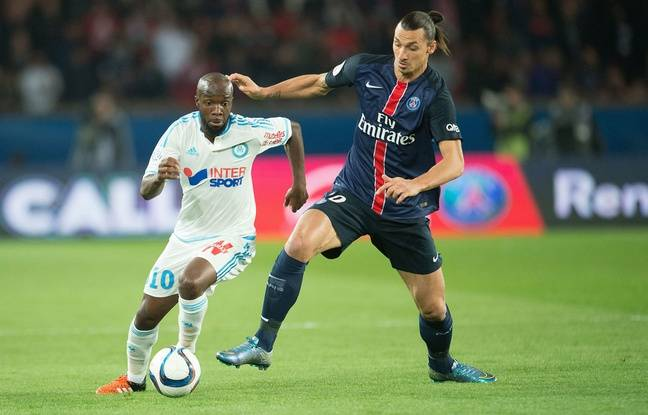 Zlatan Ibrahimovic au duel avec Lassana Diarra lors de PSG-OM le 4 octobre 2015.