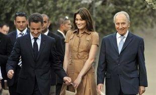 Le président Sarkozy et son épouse Carla seront lundis soir les invités d'honneur d'un dîner d'Etat offert par le président israélien Shimon Peres.