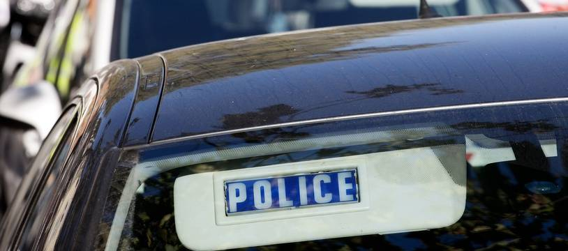 Des véhicules de police. (Illustration)