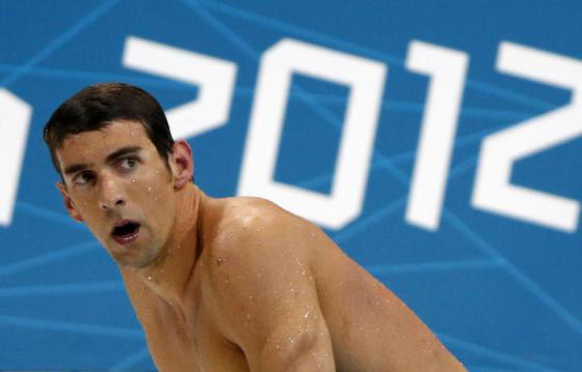 Le nageur américain Michael Phelps, après sa quatrième place lors des Jeux olympiques de Londres sur le 4X100m quatre nages, le 28 juillet 2012. – REUTERS